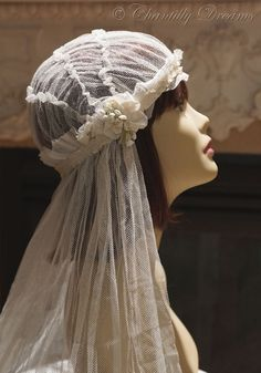 This is a breathtaking, authentic 1920s flapper Juliet cap bridal veil in a lovely shade of ivory. Description from chantillydreams.com. I searched for this on bing.com/images