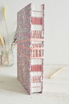 https://flic.kr/p/DthC4x | French link stitch, long stitch over vintage ribbons by Dani Fox Books