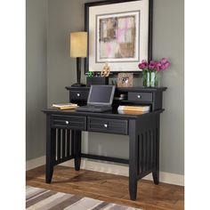 Add a fresh, contemporary look to your workspace with this black poplar student desk. This handsome desk features a hutch and two drawers for organizing and storing documents and office supplies and is built with solid materials for lasting beauty.