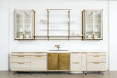 Our open concept kitchen takes inspiration from our Collector's Shelving System. Shown in Warm Brass and Bleached Oak with Ribbed Glass and Floating Glass Shelves.
