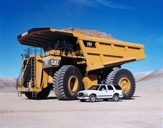 Gotta love a big truck. Caterpillar Heavy Equipment.Introduced in 1998 was this 3300hp 360 ton 797 off highway hauler