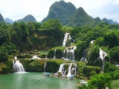 Ban Gioc Waterfall is a precious gift of nature for Cao Bang province. Travel to Vietnam and visit Ban Gioc Waterfall, you will be absolutely amazed at by Places Around The World, Oh The Places You'll Go, Places To Travel, Places To Visit, Vietnam Voyage, Vietnam Travel, Vietnam Tourism, Beautiful Waterfalls, Beautiful Landscapes