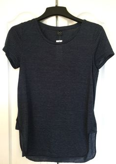 Dear Cynthie: I could use an updated tee. The softer the better. V or scoop necks are usually more flattering with my figure and all, but a simple pattern is a nice distraction too. -- xo, Kim // pinned image: Zena Knit Top