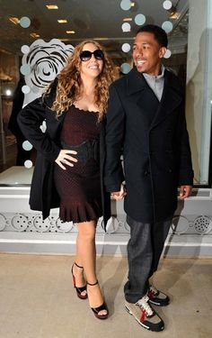 Mariah Carey Photos Photos - Mariah Carey and Nick Cannon can't keep their hands off each other as they go shopping at Dior and Louis Vuitton. The couple are celebrating their fourth year marriage anniversary, which falls on April 30th. - Mariah Carey and Nick Cannon in Paris