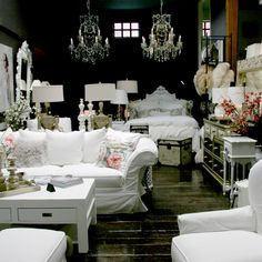 Dark with white furniture and sparkles, must have halogen lighting