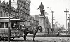 """New Orleans circa 1890. """"The Clay Monument, Canal Street."""" Fascinating details abound in this scene captured by William Henry Jackson: The 1-horsepower horsecar, the ancient carbon-arc lamp suspended from a complicated-looking boom, and much signage:  WIG MANUFACTORY, and logo of the ETV (East Tennessee, Virginia and Georgia) Railway.    ~Shorpy - The 100-Year-Old Photo Blog"""