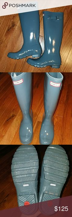 Hunter boots Tall gloss hunter boots new with box in graphite. Never worn. I ordered offline and they do not fit. Box is slightly damaged so I may not be able to ship it in box. Graphite looks like a steel blue. Hunter Boots Shoes Winter & Rain Boots