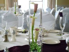 calla lily centerpieces weddings | centerpiece of picasso calla lilies in a square glass vase centerpiece ...
