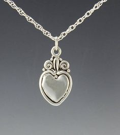Sterling Silver Handmade One of a Kind Heart Pendant. Unique design with Scrolls or Swirls which gives it a Victorian or Egyptian feel. Handmade One of a Kind Artisan Jewelry Made in the USA with Free Domestic Shipping! Sterling Silver Heart Necklace, Silver Necklaces, Sterling Silver Pendants, Gifts For Wife, Gifts For Her, Denim And Diamonds, Etsy Jewelry, Handmade Silver, Diamond Jewelry
