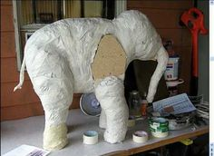 In this tutorial, learn how to make a paper mache baby elephant. To begin, you will need a pattern, which you can find at Ultimate Paper Mache. There is a grid on the pattern that you can use to expand onto a large piece of particle board. This will give you the entire body for the elephant. After you cut the elephant out of the board, glue and nail it together with spacers in between the body parts. After this, crumple up newspaper and then tape and squish it onto the wood until the…