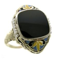 Egyptian revival, circa 1920, 18k white gold and enamel ring with onyx and pearl.