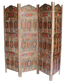 Four panel hand carved Indian screen room divider  A four panel folding Indian screen made of solid wood. Lovely double-sided hand painted four panel screen, room divider, hand carved decoration on both sides in a beautiful rich overall patina, fantastic colors, versatile piece, originally made to divide a room, so there is no front or back, both sides are equally superb, would make a great headboard, ideal in conservatory, living room and office for privacy.  Original hinges allows the…