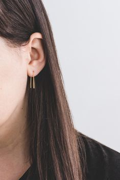 Arc Earrings. These simple minimalist earrings are fluid in design with a delicate arc and slightly flattened edge. The discreet, elegant shape is understated yet remarkable; a subtle addition that will complete your look. Shop: https://www.ohmyclumsyheart.com/products/14k-gold-arc-earrings
