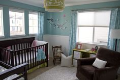 a way to do a blue wall nursery with brown furniture that doesn't look like a boys room!