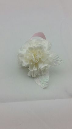 White Carnation Bouttoniere for Prom with Baby Pink and Iridescent Accent