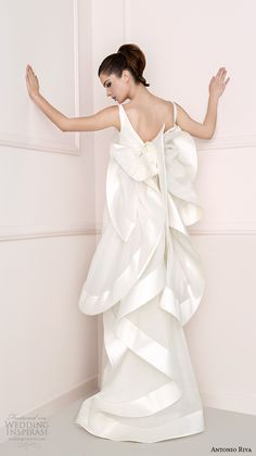 Antonio Riva 2016 Wedding Dresses | Antonio Riva's 2016 collection has all the ingredients for bridal gown perfection — gorgeous silhouettes evocative of flowers in bloom, flounces dipped in colors like soft petals, and a cool, modern aesthetic that is every contemporary bride's dream. | Wedding Inspirasi