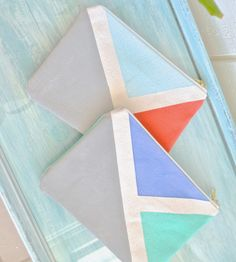 Rio Hand-Painted Triangle Zipper Pouch by Sundown Style Company on Scoutmob