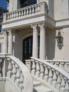 Cast stone residence with a patio and entry. Cast stone balustrade, newel piers, tapered Corinthian columns, and staircase. Stone Legends Architectural Cast Stone (600×800)