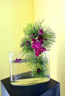 Finalist in 2013 Online Ikebana competition: glass vase, water, green (?) and orchids by Lucy | Ikebana Australia