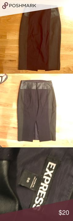 Express Faux Leather Pencil Skirt Express Faux Leather Pencil Skirt. Navy and Charcoal grey with side faux leather paneling. Size 00 but I am normally a 0 or 2 and had fit perfectly, just never wore. 🚫Trades🚫PP🚫holds. ew without tags. Just has been hanging in my closet. Express Skirts Pencil