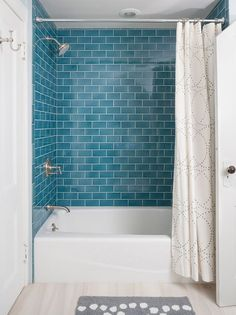 Not all the bathroom needs to be wrapped in tiles. Use them in specific areas