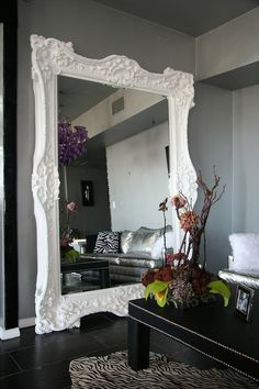 love the look of an oversized mirror leaning up against the wall!