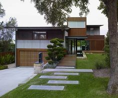 In the description for this project, there is no mention of this modern home being inspired by Asian influences but I am willing to bet the farm that it was. I love everything about this house starting with the strict geometric lines running both vertically and horizontally. The landscaping is stunning and keep with precision. ….
