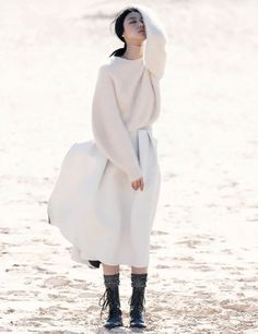 white stiff pleated skirt + crescent shaped sleeves