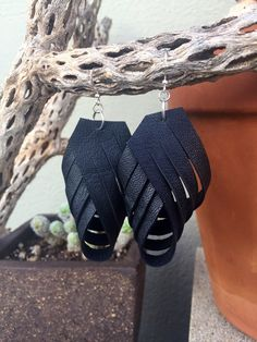 Beautiful Black leather sculpted drop earrings with nickel-free silver plated findings that are super lightweight, comfortable, and easy to wear!. All items are conceived with love from up cycled old leather jackets & leather scraps. These are about 4-5 inches long.