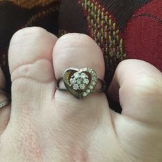 Vintage sterling heart ring size 7 Super cute vintage sterling heart ring size 7, marked .925, purchased as is, could use a cleaning, and questions are welcomed. Hippie boho vibe Jewelry Rings