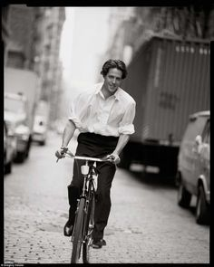 Four Weddings and a Funeral: Hugh Grant rides a bike as Heisler snaps this fun-filled this shot