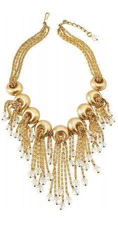 Gold-plated snail chains with dangling crystal beads emerge from concave circles on this 1950's Napier Necklace design.