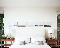 In actors Nick Offerman and Megan Mullally's Hollywood master bedroom, a row of photographs by Sze Tsung Leong is displayed with the print's side-by-side horizons set in a line—simple and clean.  Tour the entire home. Miguel Flores-Vianna  - ELLEDecor.com