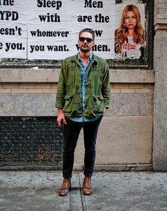 Shop this look for $144:  http://lookastic.com/men/looks/green-jacket-and-blue-denim-shirt-and-black-chinos-and-brown-boots/584  — Green Camouflage Jacket  — Blue Denim Shirt  — Black Chinos  — Brown Leather Boots