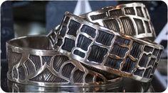 Aurora Joleen     bracelets.   http://aurorajoleendesigns.com/index.php/component/virtuemart/bracelets/giraffe-detail?Itemid=0