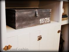 Build a box with scraps of wood and the give it an old look! I love it!