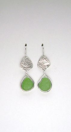 The green sea glass is genuine. They were found and supplied by...  https://www.etsy.com/shop/mamzelleseaglass and are no back bezel set. The
