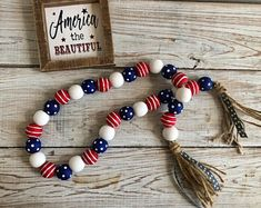 Check out our of july wooden decor selection for the very best in unique or custom, handmade pieces from our shops. Fourth Of July Decor, 4th Of July Decorations, July 4th, Buffet Decorations, Wood Bead Garland, Beaded Garland, Christmas Bead Garland, Patriotic Crafts, July Crafts