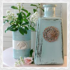 Glass Bottle and Tin Can Repurpose. http://4.bp.blogspot.com/-JPSNzpUCaew/T_euFe4yiPI/AAAAAAAAEpM/2NnNc3Yn3nY/s1600/aqua+bottle+jar+chalk+paint+home+decor+DIY.jpg