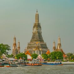 The Temple of Dawn or Wat Arun, is a Thai Buddhist temple in Bangkok. First known to the west via French maps in the reign of King Narai (1656–1688) the current spires , known as prang, rise to to 86 m (282 ft) and were built during the reign of King Rama II in the early nineteenth century. The temple sits on the west bank of the Chao