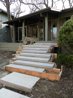 Floating concrete steps sitting in forms are sitting upon a 2' footer that supports the steps from the middle. www.onespecialty.com