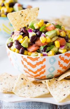 Completely addicting corn salsa packed with avocado, black beans, cilantro, and plenty of flavor! A fiesta in a bowl, if you will. Mexican Food Recipes, Vegetarian Recipes, Cooking Recipes, Healthy Recipes, Corn Salsa Recipes, Riviera Maya, Salsa Guacamole, Salsa Salad, Avocado Dip