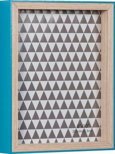 A teal blue and natural wood frame has a 8 geometric black and white background that's almost cute enough to be the artwork itself! Hang on wall or stand on tabletop. Suitable full framed for 8 x 10 photos.
