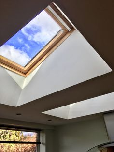 Watch the clouds go by, daylight and the stars in the sky through VELUX roof windows window ideas Bringing the outside in Skylight Window, Roof Window, Diy Skylight, Roof Ceiling, Ceiling Lights, Roof Light, Arched Windows, Flat Roof, Interior Design Living Room