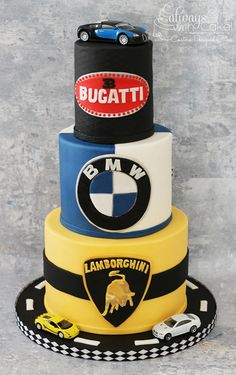 Who doesn't want at least one of these cars? Hand painted and hand cut logos out of fondant.