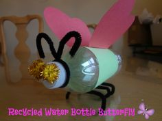 Use an old water bottle to make a Recycled Water Bottle Butterfly and teach your children how recycling can be used to take something old and make it into something new! via www.jmanandmiller...