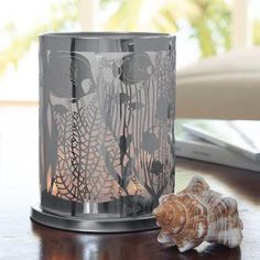 """Undersea enchantment! Intricate aquatic scene mesmerizes with candlelight sparkle. Photo-etched metal hurricane lined with light-diffusing mesh. Includes glass cup for tealights and votives, sold separately. 6¾""""h; 5¾""""w. Universal Tealight® CandleVotive Was $45.00 each  Now $32.00 each"""
