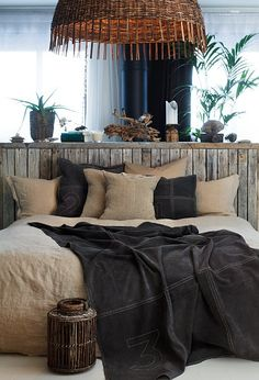 brown bedding, wood headboard -nice light