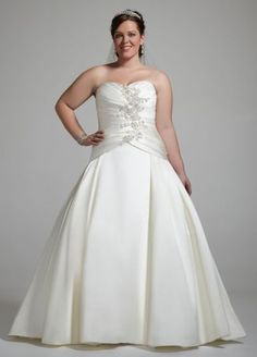 Timeless elegance meets Hollywood glamour for a simply breathtaking result. This spectacular andstriking ball gown gives a new meaning to the term show stopper.   No detail is overlooked in this gorgeous satinstrapless Cassini gown featuring a center beaded floral applique on bodice.  Covered button detailing lends the extra touch needed for the ultimate polished look.  Dropped waist with ruching on bodice promises a beautiful silhouette.  Chapel train. Fully lined. Back ...