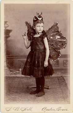 Fairy girl. Post mortem photo, you can see the stand holding her up, and her eyes are painted on